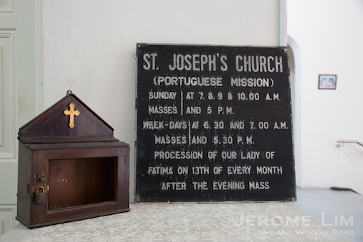 An old letter box and signboard for the church now displayed in Parochial House.