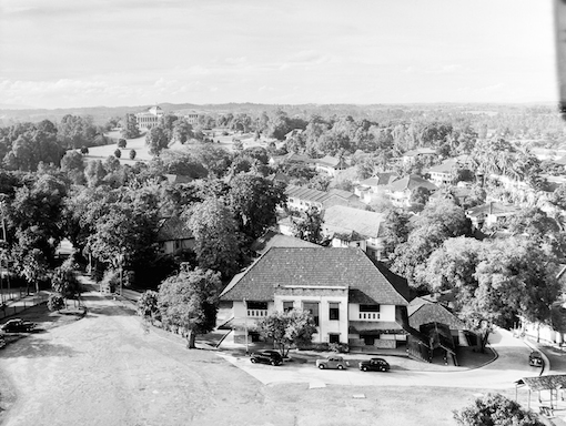 A view across Mount Sophia towards Mount Caroline and Government House. The building in the foreground is Olson Building - the only one of the buildings of the former Methodist Girls School that is being conserved.