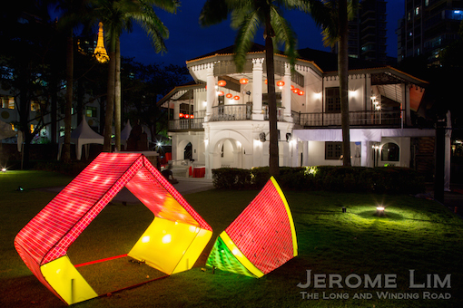A pair of lanterns depicting the watermelon playground at Tampines.
