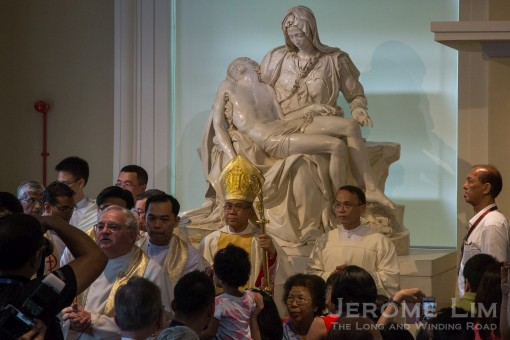 Archbishop William Goh after unveiling a new Pietà before the opening mass.